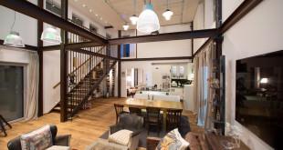Hohe Räume und die Kombination von Küche, Ess- und Wohnzimmer schaffen Loft-Flair. Zugleich entsteht durch diesen Aufbau eine neuartige Flexibilität in der Hausbauplanung. Bild: tdx/ELK Fertighaus