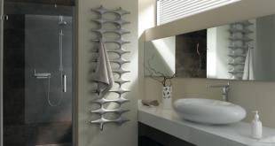 Ideos – sternförmige Elemente verbinden sich zu einem skulpturalen Designobjekt. Wahlweise erhältlich mit optisch perfekt angepasstem Handtuchbügel oder –haken und vielen Farben. Foto: Kermi GmbH/akz-o